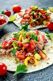 Tuna Tortilla with avocado, fresh salsa, limes, greens, parsley, tomatoes, red yellow pepper. colorful vegetable Royalty Free Stock Photo