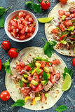 Tuna Tortilla with avocado, fresh salsa, limes, greens, parsley, tomatoes, red yellow pepper. colorful vegetable Stock Image