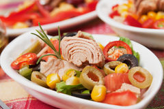 Tuna and vegetable salad. Tuna salad with olives, tomato, corn and lettuce Stock Photography