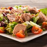 Tuna and vegetable salad. On wooden background Stock Photo