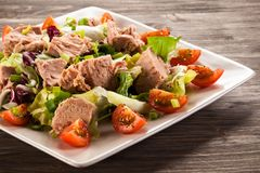 Tuna and vegetable salad. On wooden background Royalty Free Stock Photography