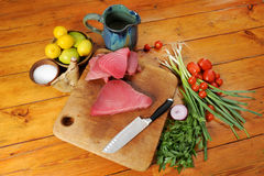 Tuna and vegetable still life. Tuna and vegetables slow food royalty free stock photography
