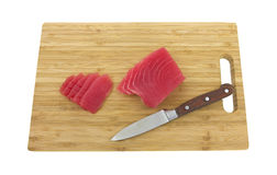 Tuna on wood cutting board Stock Photo