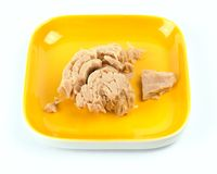 Tuna on yellow plate on white background Stock Photo