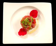 Tunaand mango tartare with rose pedals Stock Image