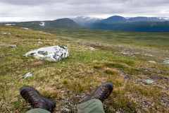 Tundra Landscape and Feets of the Traveller Royalty Free Stock Image