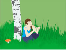 Tune. Girl, sitting in grass near birch and playing with tune Stock Images