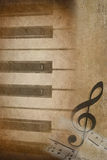 Piano keys with treble clef. Old-fashioned grunge layers on piano keys and musical symbols Stock Photos