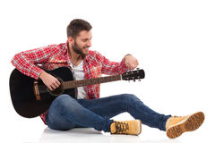 Tune guitar before play Stock Photos