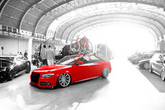 Tuned Audi S4 with red bike Stock Photography