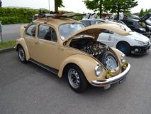 Tuned Beetle. A tuned 70s Volkswagen Beetle seen at as tuners event near Bergamo. The model shown in the picture had alloy wheels, personalized paint and a Royalty Free Stock Photos