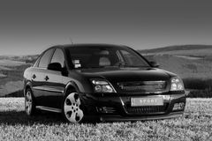 Tuned Car. Tuned black car in rural scenery Royalty Free Stock Photos