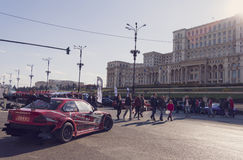 Tuned car at Bucharest Auto Show in front of the Palace of the Parliament Stock Image