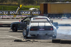 Tuned cars drifting. Very close on track during the 6th stage of the European Drifting Championship in Constanta, Romania. Lots of smoke from the tires. Photo stock photography