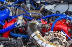 Under the hood of a sports car. Tuned parts under the hood of a sports car Royalty Free Stock Photography