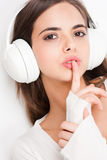 Tuned in. Portrait of a beautiful young brunette woman listening to music in headphones stock photos