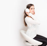 Tuned in. Portrait of a beautiful young brunette woman listening to music in headphones Stock Image