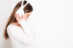 Tuned in. Portrait of a beautiful young brunette woman listening to music in headphones Royalty Free Stock Photo