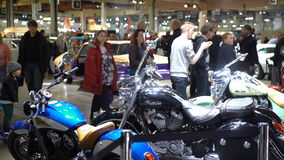 Tuned Vintage motorcycles on display. HELSINKI, FINLAND - APRIL 16, 2017: Tuned Vintage motorcycles on display. The 40th American Car Show in Helsinki Fair stock video footage