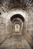 Tunel in a crypt. Bellow a church in Monastery of Leyre in Navarra, Spain royalty free stock photography