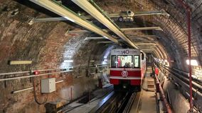 Tunel (metro) train arriving  Karakoy station in Istanbul, Turkey. Istanbul, Turkey - January 13, 2016: Tunel train arriving  Karakoy station in Istanbul on stock video footage