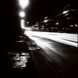 Tunel z poruszającymi światłami ruchu w czarny i biały Obrazy Royalty Free