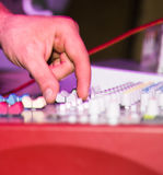 The tuner adjusts in the music console.  Stock Photos