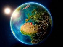 Tunesië met zonsondergang van ruimte royalty-vrije stock afbeeldingen