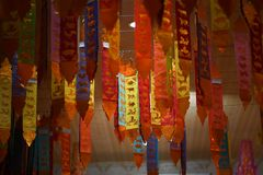 Tung traditional northern Thaiand flag, 12 zodiac vertical flag, decorated in a buddhist temple stock photos