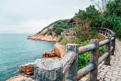 Sea and hiking road in Cheung Chau island, HongKong. Tung Wan Tsai Coral Beach and hiking trail road in Cheung Chau island, HongKong royalty free stock photo