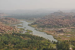 Tungabhadra river and the mountains, Hampi, India Royalty Free Stock Photo