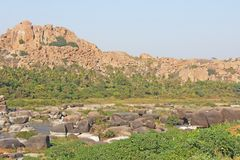 Tungabhadra river in the village of Hampi. Big stone. Tropical e. Xotic landscape. Beautiful green valley. View from above royalty free stock photography