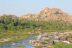 Tungabhadra river in the village of Hampi. Big stone. Tropical e. Xotic landscape. Beautiful green valley. View from above royalty free stock images