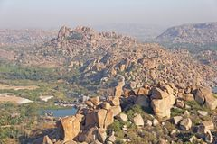 Tungabhadra river in the village of Hampi. Big stone. Tropical e. Xotic landscape. Beautiful sunrise valley. View from above royalty free stock photo