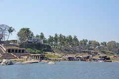Tungabhadra river in the village of Hampi and the transfer of lo. Cal residents and tourists to the other shore. Big stone. Tropical exotic landscape. Beautiful royalty free stock photo