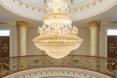 A tungsten bulb crystal chandelier. Royalty Free Stock Images