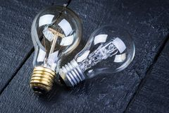 Tungsten bulbs on a black wooden table Royalty Free Stock Image