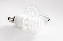 Tungsten and energy saving lightbulb Stock Photography