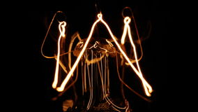 Tungsten filament of electric bulb stock footage