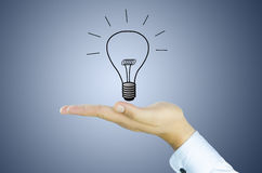 Tungsten lamp on human hand Royalty Free Stock Image