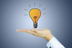 Tungsten lamp on human hand Royalty Free Stock Photography
