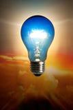 Tungsten light. Conceptual over sun set sky background Stock Image
