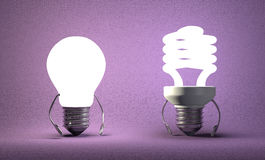 Tungsten light bulb character and fluorescent one Royalty Free Stock Photos