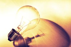 Tungsten light bulb. And shadow Royalty Free Stock Photography