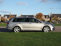 Side profile of a VW Golf Estate on a late autumn day. Tungsten silver Volkswagen Golf MK7 estate, variant, with Team Dynamics Pro Race 3 Alloys. Parked next to royalty free stock photos