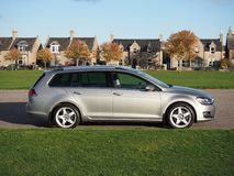 VW Golf Estate on a late autumn day. Tungsten silver Volkswagen Golf MK7 estate, variant, with Team Dynamics Pro Race 3 Alloys. Parked next to playing fields stock photography