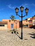 Tungsten streetlights in village square Royalty Free Stock Image