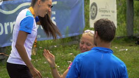 TUNGUR, RUSSIA - 07.2016: award ceremony of ALTAY ULTRA TRAIL. Young beautiful girl is awarded a gold medal for the first place stock footage