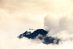 Tungurahua Volcano Covered By Ice. Discrete View Of The Tungurahua Volcano On Through The Clouds Stock Photos