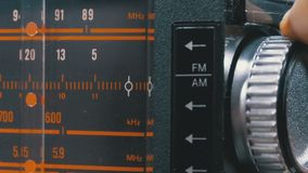 Tuning analog radio dial frequency on scale of the vintage receiver. The frequency label moves in the range 89 - 108 MHz, and also over long, medium and short stock video